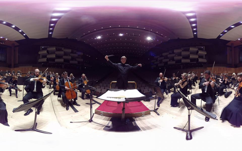Conductor Esa-Pekka Salonen and Philharmonia Orchestra on stage during a VR performance