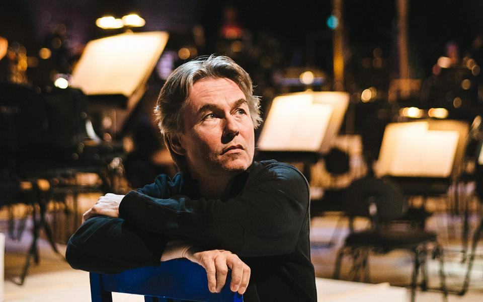 Esa-Pekka Salonen sitting on a chair