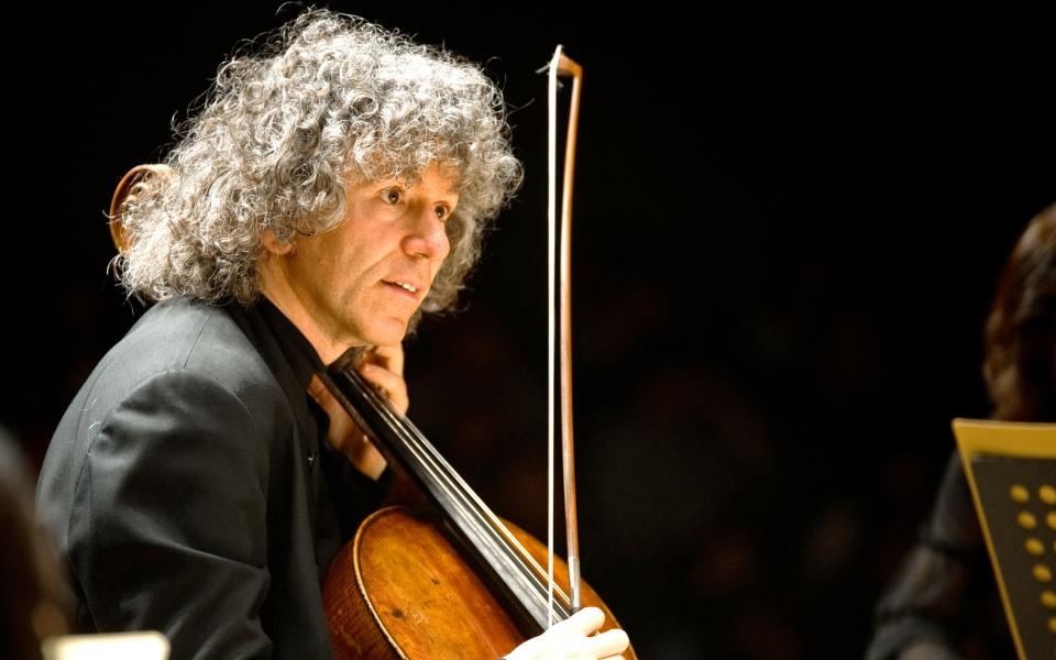Cellist Steven Isserlis on stage, playing