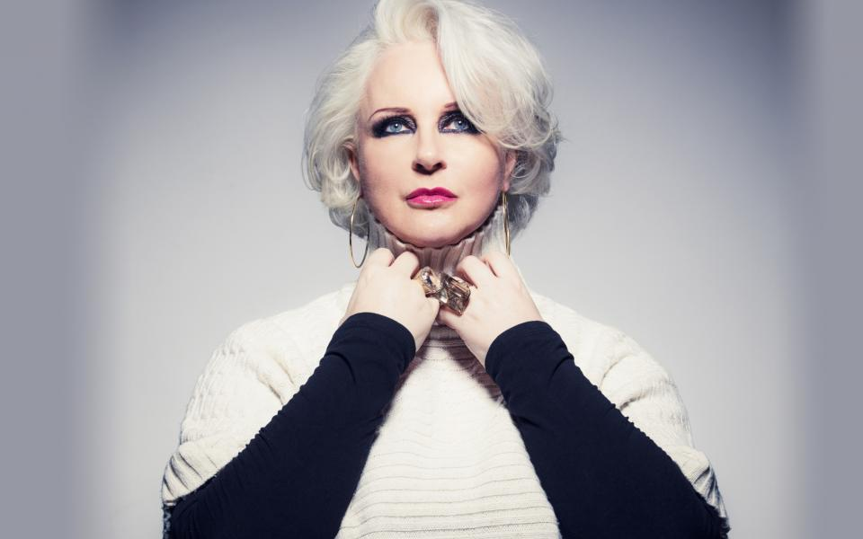 Singer Irene Theorin wearing a white jumper over a black shirt and jewelry