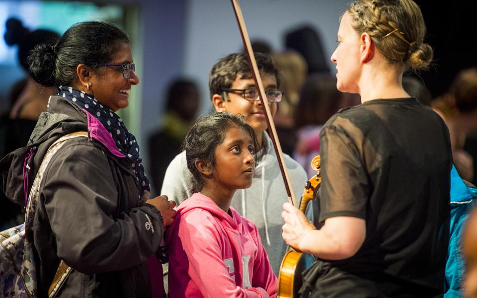 Emily Davis, second violin, meeting audience after family concert