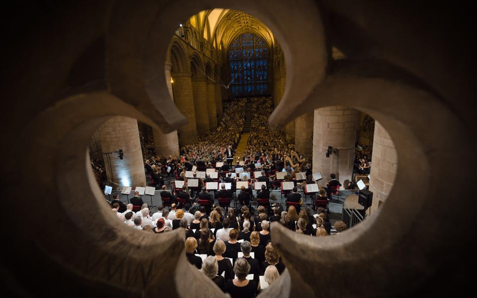 Cathedral concert at Three Choirs Festival, seen through a window shaped like a clover
