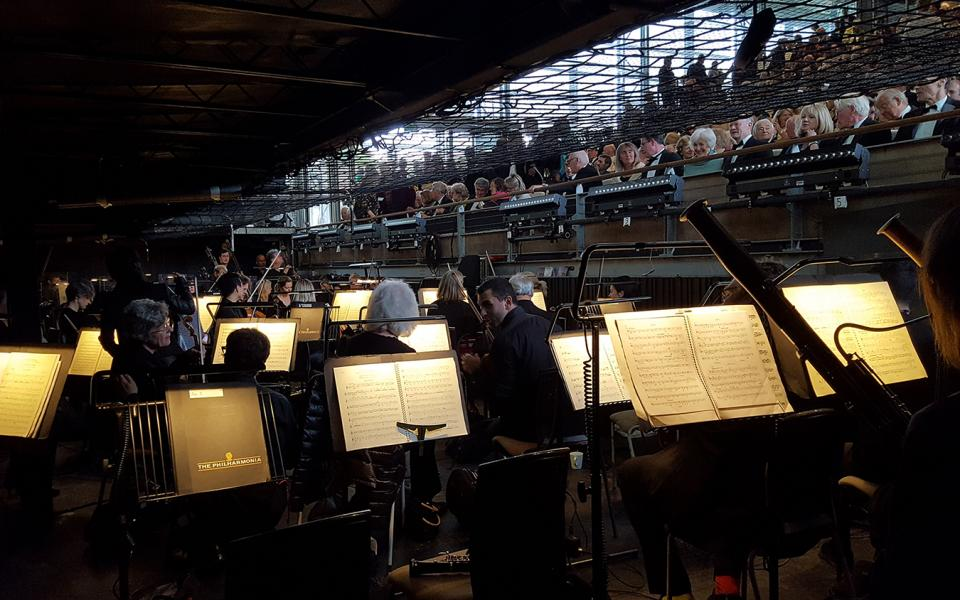 View from the pit of Garsington Opera, orchestra in the foreground, audience in the back