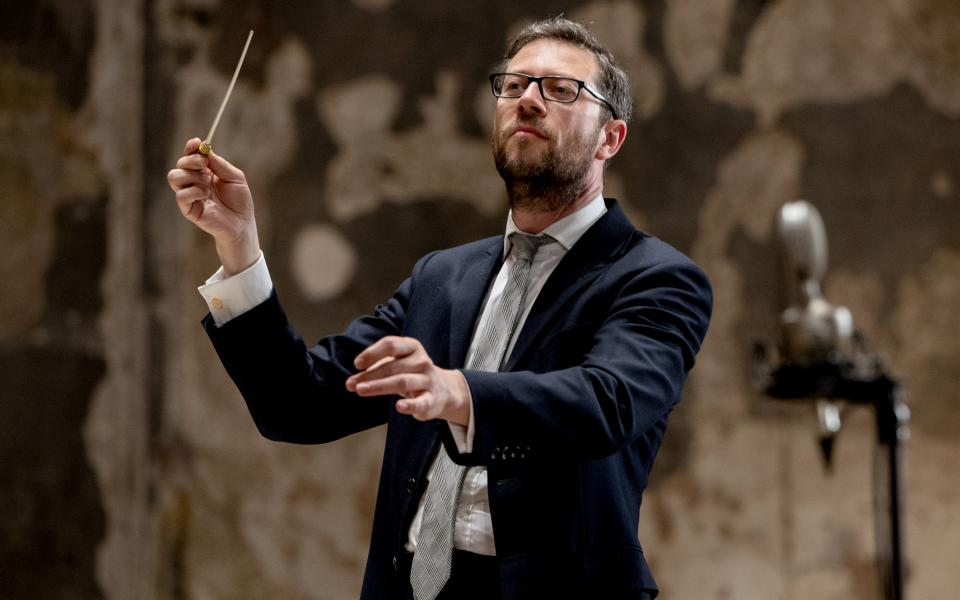 John Wilson conducting on stage